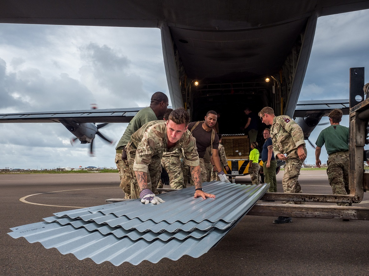 A Royal Canadian Air Force CC-130J Hercules aircraft delivers humanitarian aid and disaster relief from the UK Department for International Development (DfID) to Grand Turk, part of the Turks & Caicos Islands, on 20 September 2017. Photo: Sqn Ldr Andy Wasley, Courtesy, Royal Air Force