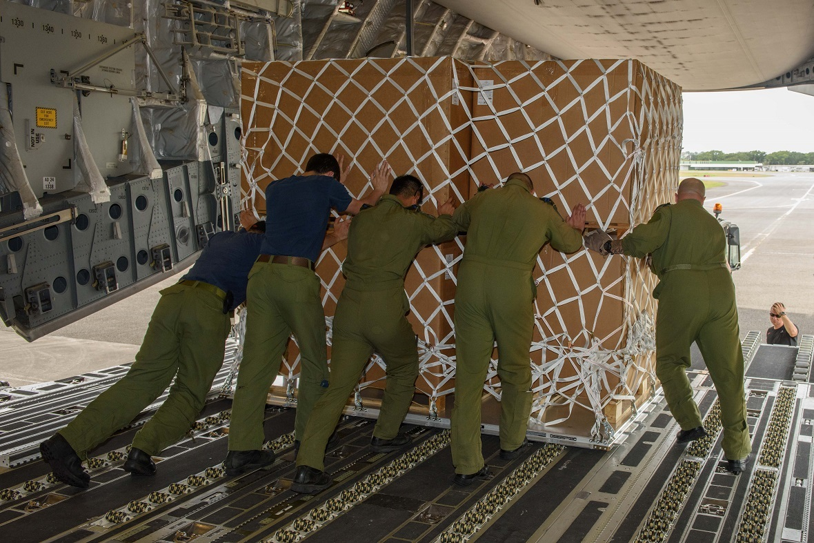 Canadian Armed Forces members unload disaster relief supplies from a CC-177 Globemaster at the airport in Point-à-Pitre le Raizel in Guadeloupe during Operation RENAISSANCE to assist in humanitarian relief efforts following Hurricane Irma, September 13, 2017. Photo by: MCpl Louis Brunet, Canadian Air Force Public Affairs