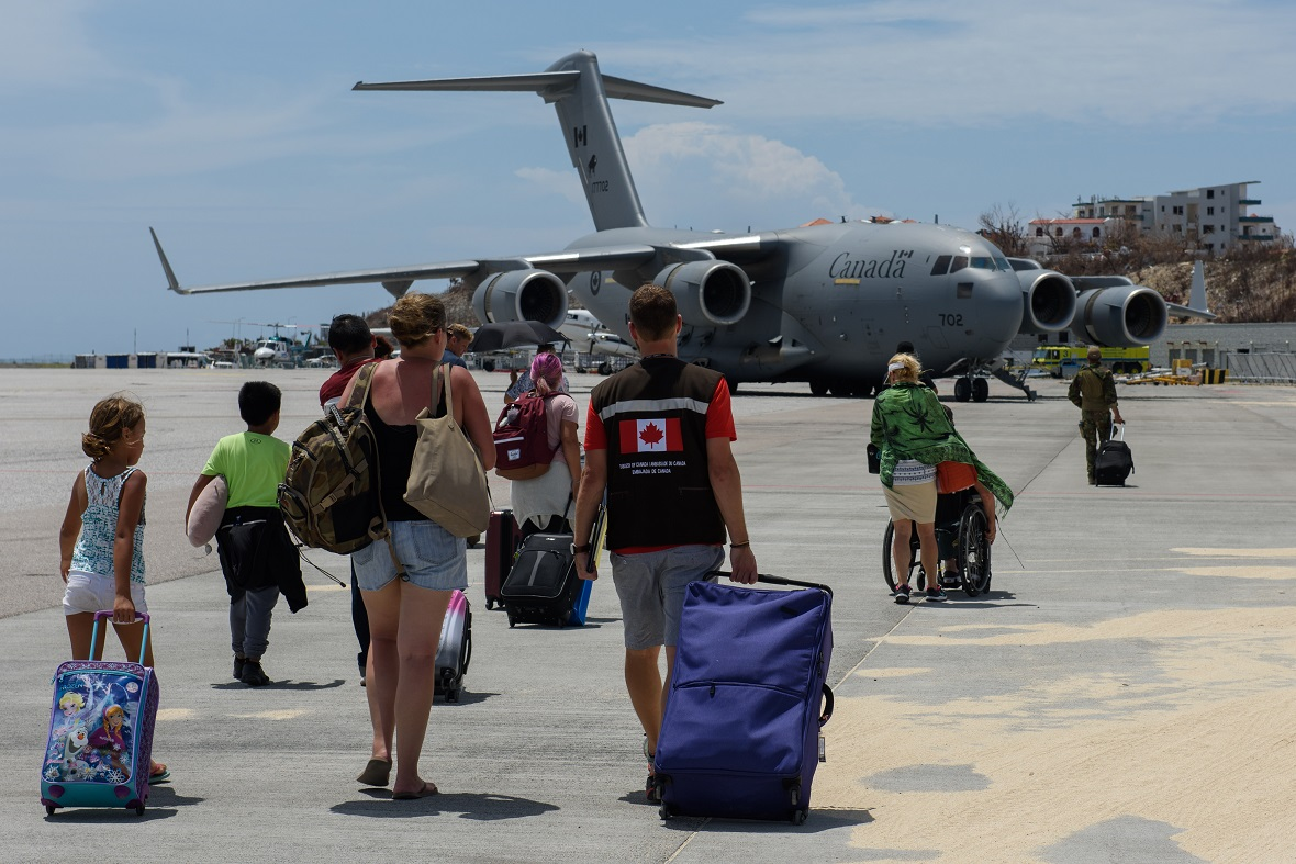 September 14, 2017 – Canadian nationals stranded in the Caribbean following Hurricane Irma board a Royal Canadian Air Force CC-177 Globemaster departing from St. Maarten as part of Operation RENAISSANCE (Irma). (Photo: MCpl Louis Brunet, Royal Canadian Air Force Public Affairs)