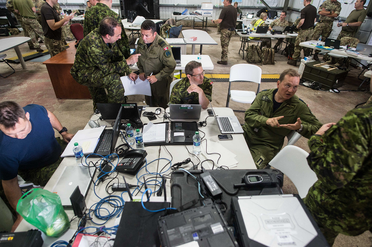 Members of the Royal Canadian Air Force and the British Royal Air Force conduct operations out of Operation RENAISSANCE Task Force Headquarters at Grantley-Adams International Airport, Barbados, September 17, 2017. Photo: Cpl Gary Calvé