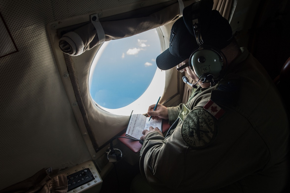 A CP-140 Aurora aircraft technical crewman participates in a reconnaissance mission over the British Virgin Islands as part of Operation RENAISSANCE, September 21, 2017. Photo: Corporal Gary Calvé, Imagery Technician, ATF RENAISSANCE