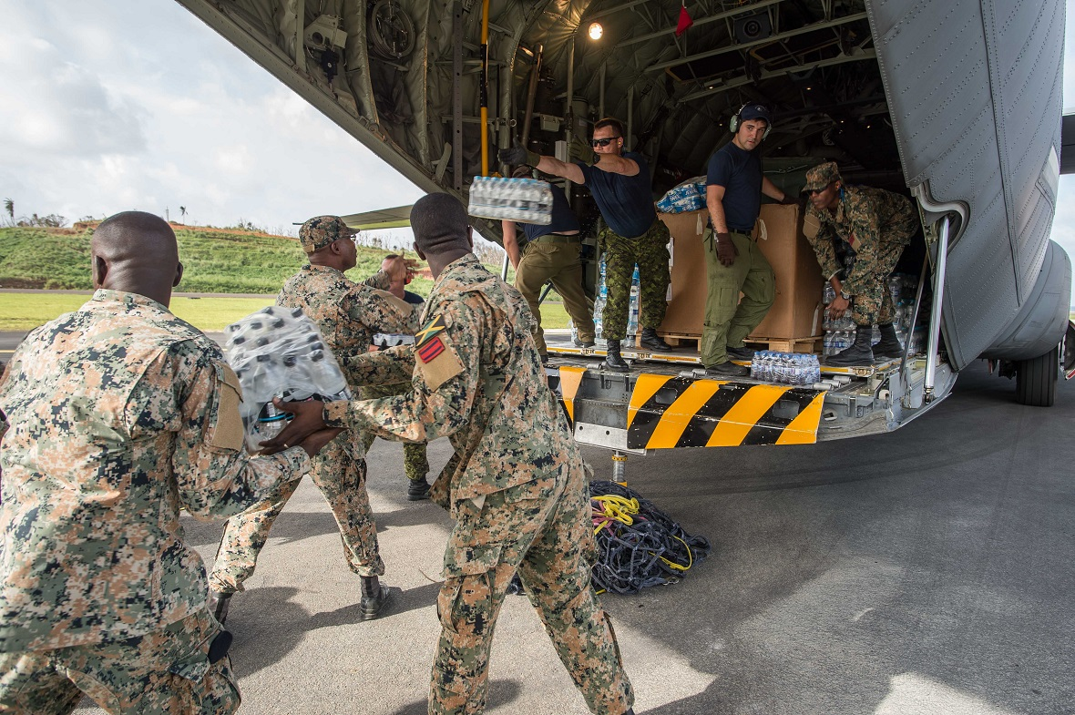 Members of the Canadian Armed Forces and the Jamaican Defence Forces Disaster Assistance Response Team load supplies into the CC-130J Hercules in Kingston, Jamaica on September 27, 2017 during Operation RENAISSANCE IRMA-MARIA. Photo: Corporal Gary Calvé.