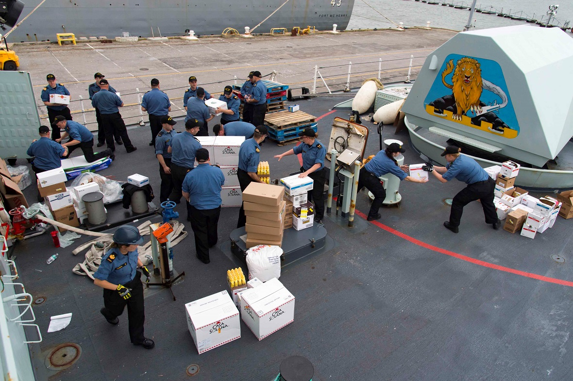 Crew members from HMCS ST. JOHN'S receive supplies at Norfolk Naval Base in West Virginia before departing on Operation RENAISSANCE to assist in humanitarian relief efforts following Hurricane Irma, September 11, 2017. Photo by: MCpl Chris Ringius, Formation Imaging Services