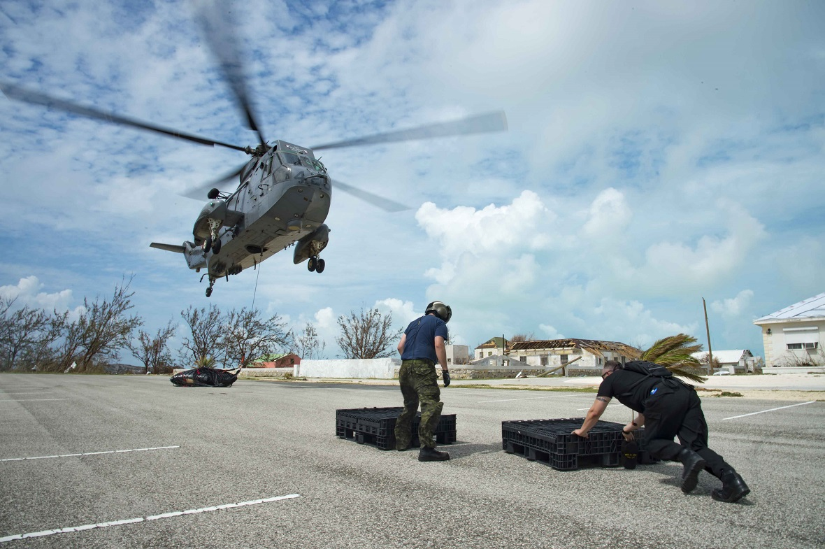 September 16, 2017 – A CH-124 Sea King helicopter from Her Majesty's Canadian Ship St. John's air lifts a water bladder to South Caicos Island to provide humanitarian assistance in the wake of Hurricane Irma's devastation as a part of Operation RENAISSANCE. (Photo: MCpl Chris Ringius, Formation Imaging Services Halifax)