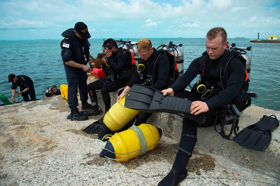 September 17, 2017. Divers from Her Majesty's Canadian Ship St. John's prepare to inspect a jetty on South Caicos Island during Operation RENAISSANCE, the Hurricane Irma humanitarian aid mission in the Caribbean, on September 17, 2017. Photo: MCpl Chris Ringius, Formation Imaging Services Halifax.
