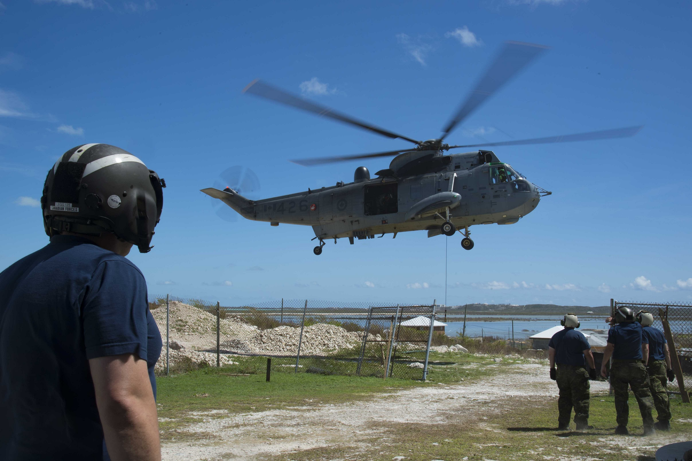 September 19, 2017. A CH-124 Sea King helicopter air lifts supplies to South Caicos Island during Operation RENAISSANCE IRMA, the Hurricane Irma humanitarian aid mission in the Caribbean, on September 19, 2017. Photo: MCpl Chris Ringius, Formation Imaging Services Halifax