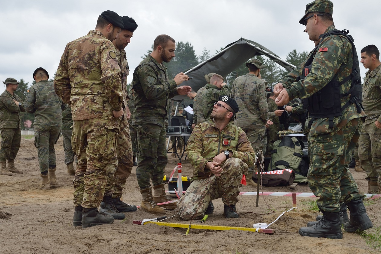 Albanian, Spanish and Italian soldiers discuss equipment at Camp Ādaži, Latvia while all nations participating in the  enhanced Forward Battle Group Latvia share and display vehicles and equipment, allowing all Allies to be familiar with the equipment each nation uses.