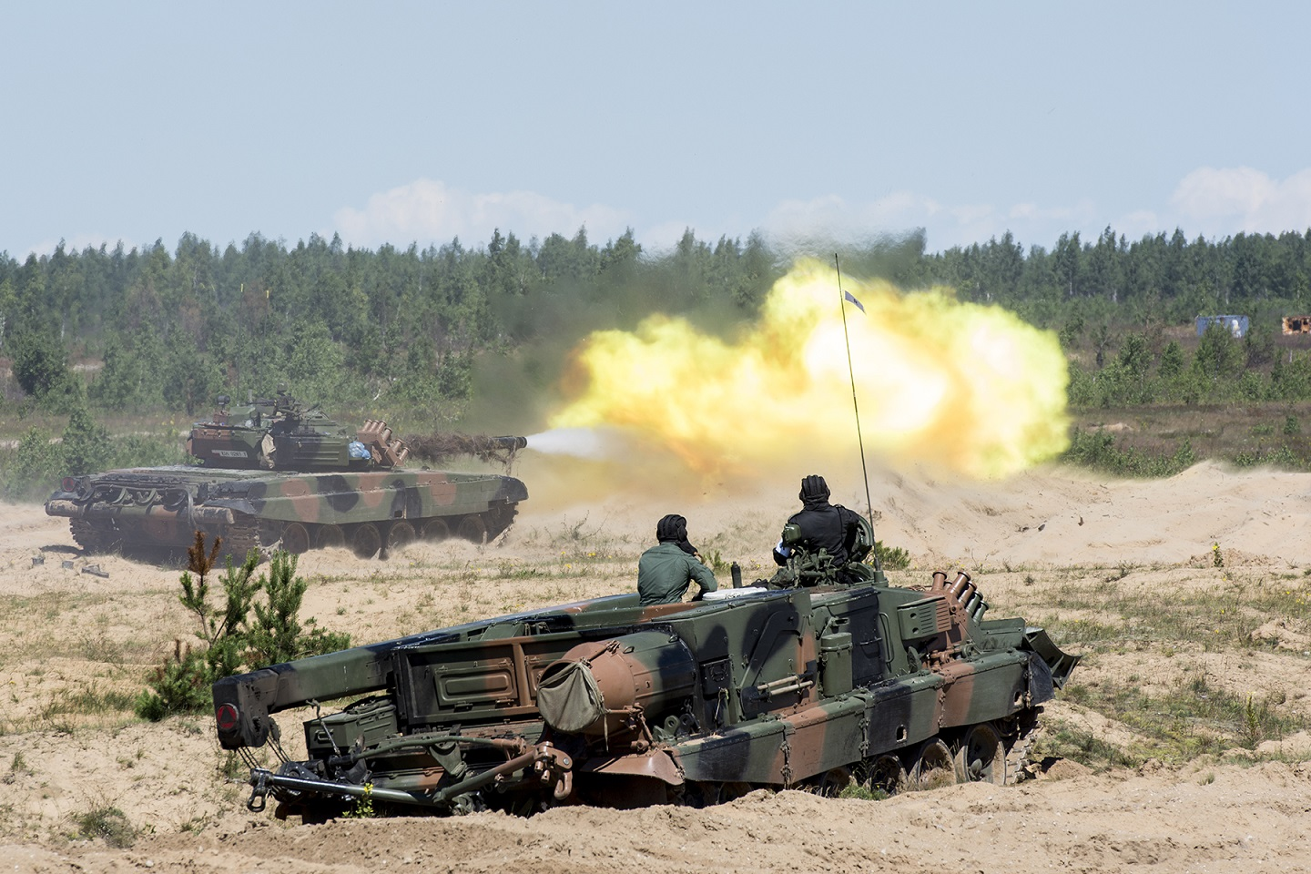 A Polish T-91 tank, part of the enhance Forward Presence Battlegroup Latvia, fires at its target in the training range of   Camp Ādaži in Latvia, on July 14, 2017.