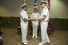 Commodore Bilal Abdul Nasir, Pakistan Navy (left) hands over command of Combined Task Force  150 (CTF 150 ) to Commodore Haydn C. Edmundson, Royal Canadian Navy (right) while Vice Admiral Kevin M. Donegan, Commander, U.S. Naval Forces Central Command, U.S. 5th Fleet, Combined Maritime Forces (centre) presides on December 8, 2016 at Naval Support Activity, Manama, Bahrain. CTF 150 is one of three task forces operated by Combined Maritime Forces. Its mission is to promote maritime security in order to counter terrorist acts and related illegal activities, which terrorists use to fund or conceal their movements.