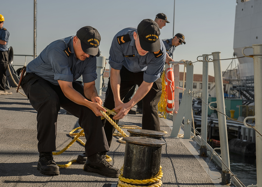 October 9, 2017. Sailors onboard Her Majesty's Canadian Ship NANAIMO secure a line while departing San Diego, California for Operation CARIBBE on October 9, 2017. Photo: MARPAC Imaging Services