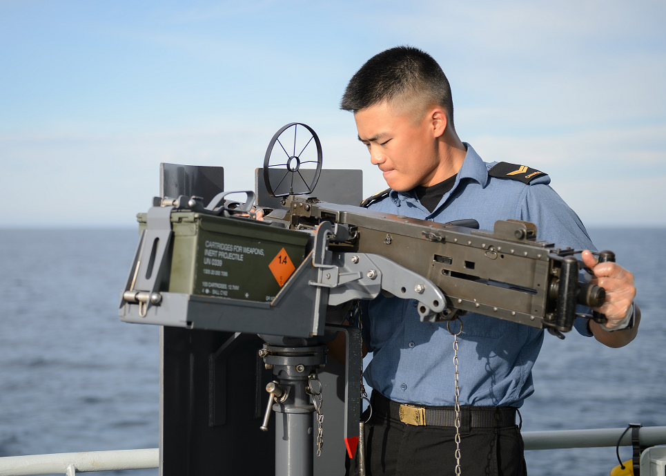 October 9, 2017. A sailor on board Her Majesty's Canadian Ship NANAIMO secures the .50 calibre gun on the bridge wing after cleaning on the way to join Operation CARIBBE on October 9, 2017. Photo: MARPAC Imaging Services