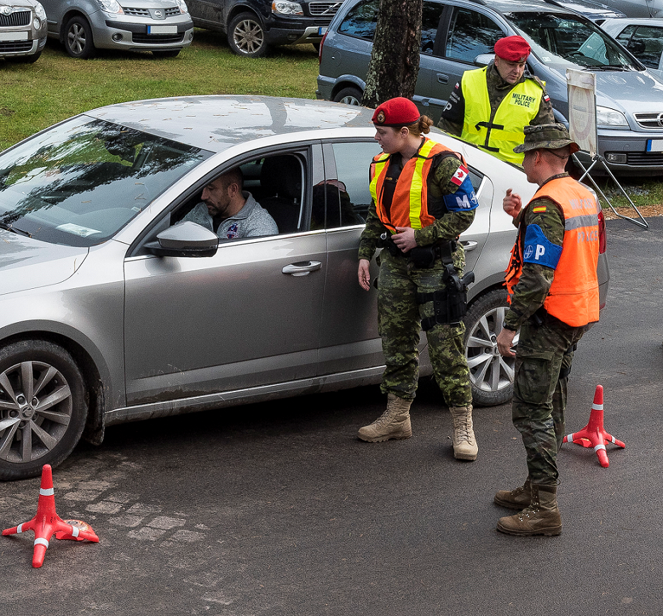 October 11, 2017. Military police from Canada, Poland, Slovenia and Spain, who are part of the enhanced Forward Presence Battlegroup Latvia alongside Latvian military police, conduct a simulated vehicular check as part of the joint training to build interoperability during Operation REASSURANCE at Camp Ādaži, Latvia on October 11, 2017. Photo: Sergeant Bernie Kuhn, Task Force Latvia