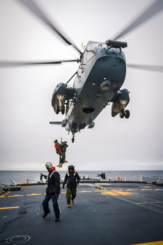 Members of Her Majesty's Canadian Ship (HMCS) St. John's air detachment perform hoisting drills with the embarked CH-124 Sea King helicopter while transiting across the North Atlantic on January 17, 2018. Photo: Corporal Tony Chand, Formation Imaging Services