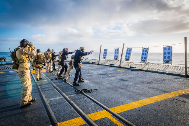 Maritime Tactical Operations Group (MTOG) Tiger Team and Royal Canadian Navy Ship's Boarding Party members conduct pistol training on the flight deck of Her Majesty's Canadian Ship (HMCS) St. John's during Operation REASSURANCE, off the Norwegian coast on February 21, 2018. Photo: Corporal Tony Chand, Formation Imaging Services