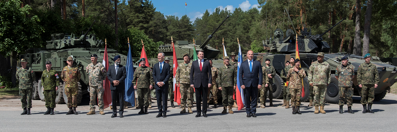 June 19, 2017. Chiefs of Defence from the six contributing nations stand with Canada's Defence Minister, Harjit Sajjan; NATO Secretary General, Jens Stoltenberg; The President of the Republic of Latvia, Raimonds Vējonis and Latvia's Minister of Defence, Raimonds Bergmanis after the ceremony that marks the standup of the enhanced Forward Presence Battlegroup at Camp Ādaži, Latvia on June 19, 2017. (Photo: MCpl True-dee McCarthy, Canadian Forces Combat Camera) IS05-2017-0051-012