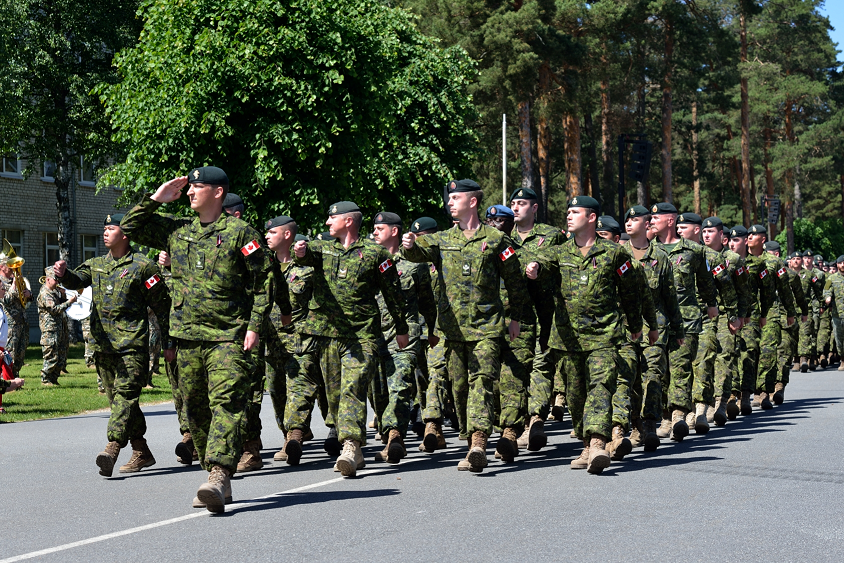 June 19, 2017. Canadian troops proudly march past during the ceremony that marks the standup of the enhanced Forward Presence Battlegroup Latvia at Camp Ādaži, Latvia on June 19, 2017. (Photo: MCpl Gerald Cormier, eFP Latvia Public Affairs)