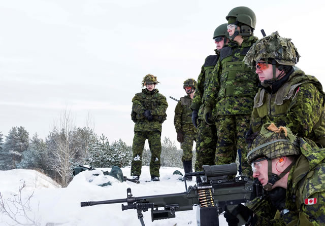 Canadian soldiers from India Company give a demonstration of the C-9 light machine gun to Julie Payette, Governor General of Canada during Her Excellency's visit to the Canadian-led multinational NATO enhanced Forward Presence Battlegroup Latvia at Camp Ādaži, Latvia on January 19, 2018. Photo: Sergeant Bernie Kuhn, Task Force Latvia