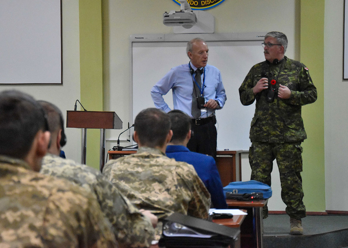 Lviv, Ukraine. November 7, 2016 – Mr. Jacques Michaud, Joint Task Force – Ukraine Flight Safety Course Director (left), and Major Paul Rickards, Acting Deputy Commander of JTF-U (right), provide opening remarks to Ukrainian students during the first day of the first Flight Safety Course on Op UNIFIER at the Hetman Petro Sahaidachny National Army Academy. (Photo : Joint Task Force – Ukraine)