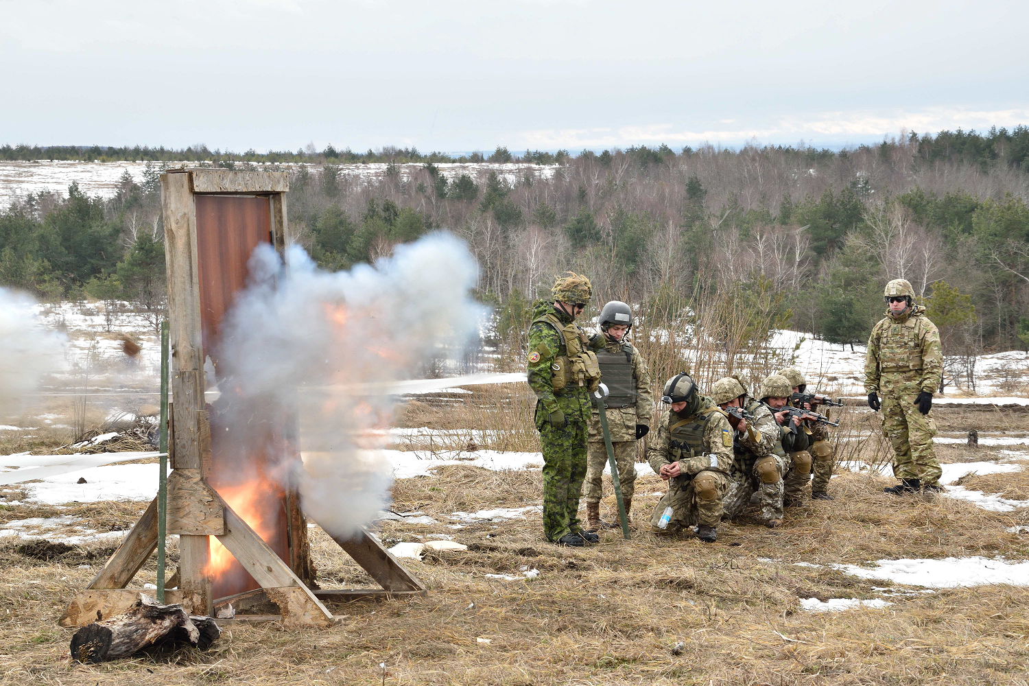 February 23, 2017. A Ukrainian soldier detonates a charge during explosive door breaching practice with Canadian and American combat engineer instructors of Joint Task Force – Ukraine during Operation UNIFIER at the International Peacekeeping and Security Centre in Starychi, Ukraine on February 23, 2017. (Photo: Joint Task Force – Ukraine)