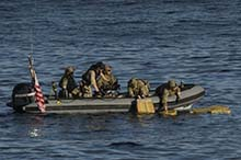 Sailors from Her Majesty's Canadian Ship EDMONTON and members of United States Coast Guard recover bales of illicit drugs from the Eastern Pacific Ocean during Operation CARIBBE on November 17, 2016. (Photo: MARPAC Imaging Services)