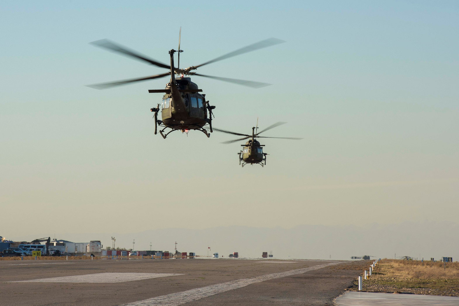 February 20, 2017. Two CH-146 Griffon helicopters take off from the flight line near Camp Érable, Iraq during Operation IMPACT on February 20, 2017. (Photo: Op Impact, DND)