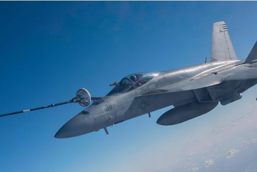 The CC-150T Polaris Air Task Force Iraq crew performs an air to air refueling mission with an USN F-18E fighter jet during Operation IMPACT in February 2018. Photo: Op IMPACT, DND KW08-2018-0136-063