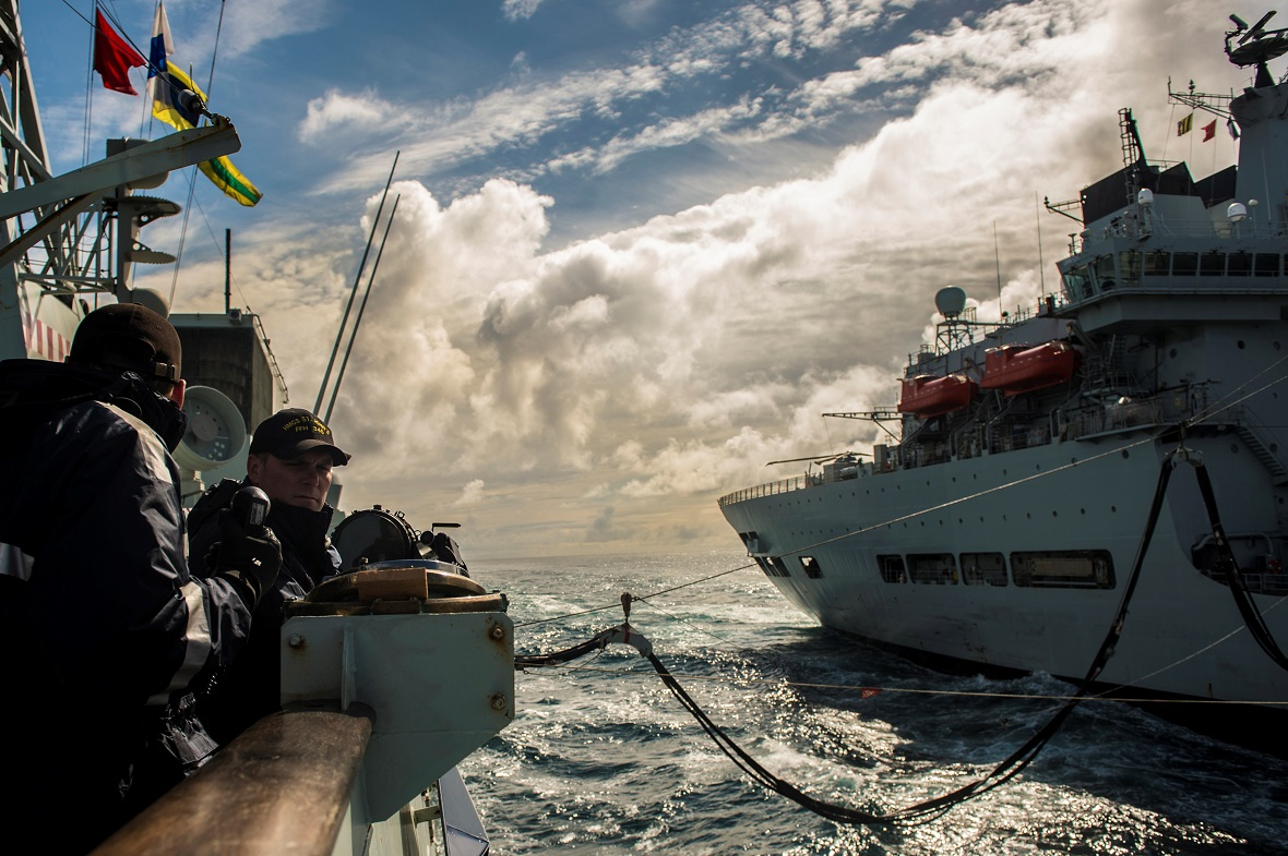 Operations Room Officer (ORO) Lieutenant (N) Jason Aitken takes temporary control of HMCS ST JOHN'S during a fuel replenishment at sea with the British Naval Vessel WAVE RIDER as they transit the North Atlantic Ocean on Exercise DYNAMIC MONGOOSE during Operation REASSURANCE, July 2, 2017. Photo: LS Ogle Henry, Formation Imaging Services