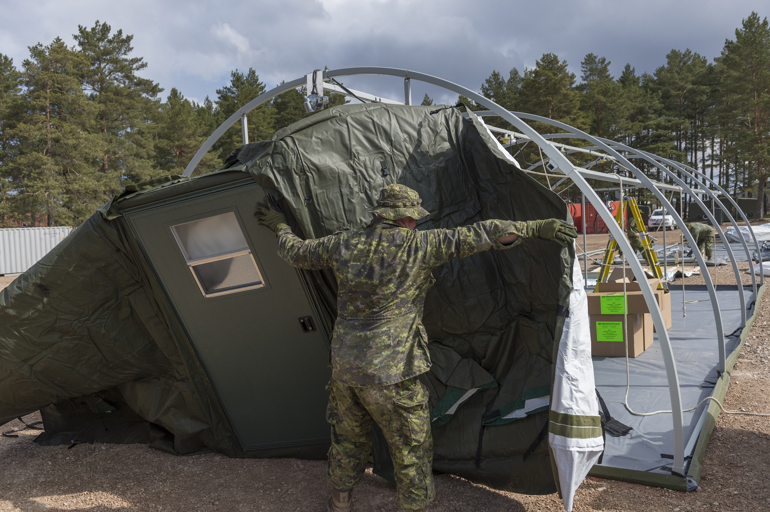 11 May 2017. Canadian troops from the Theatre Opening Team prepare an accommodation area at Camp Adazi, Latvia, on May 11, 2017, in advance of the arrival of NATO's enhanced Forward Presence multinational battlegroup in Latvia.