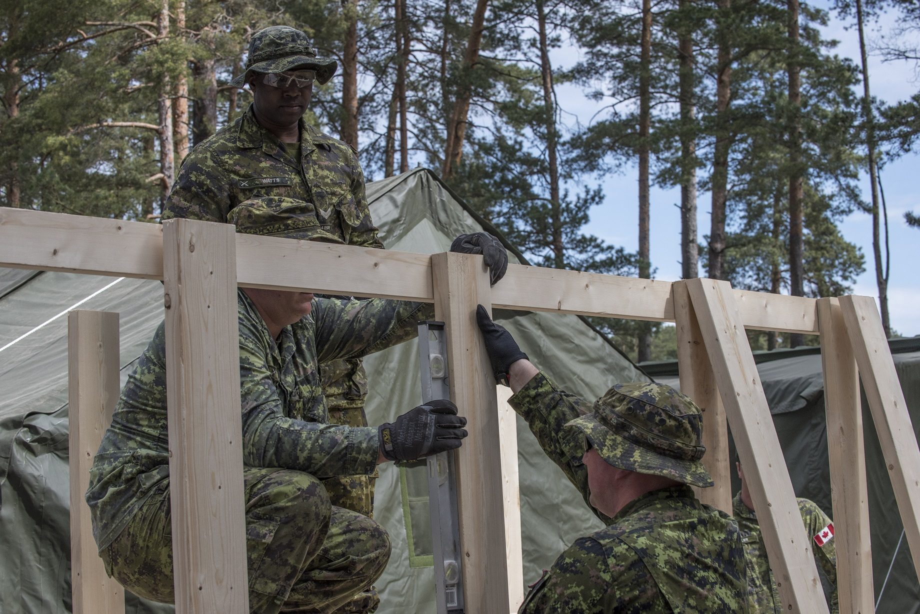 May 23, 2017. Members from the Theatre Opening Team, build a bridge over the plumbing of Life Support Area (LSA) 2, at Camp Adazi, Latvia, on May 23, 2017, in advance of the arrival of NATO's enhanced Forward Presence multinational battlegroup in Latvia.'