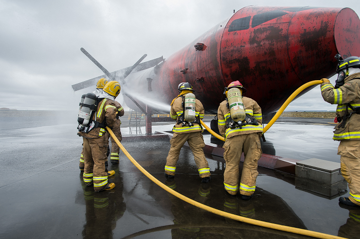May 27, 2017. A team of Royal Canadian Air Force firefighters from Air Task Force-Iceland (right) and a team of local airfield firefighters from the Keflavik International Airport (left) extinguish a fire on an aircraft during a readiness training scenario as part of Operation REASSURANCE in Keflavik, Iceland on May 27, 2017. (Photo: Cpl Gary Calvé, Imagery Technician, ATF-Iceland)