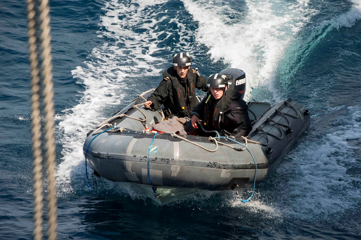 Canadian Armed Forces members aboard a Rigid Hulled Inflatable Boat approach Her Majesty's Canadian Ship Charlottetown during a training activity in the Atlantic Ocean on August 11, 2017, as part of Operation REASSURANCE. Photo: Corporal J.W.S. Houck - Formation Imaging Services