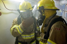 November 20, 2017. Sailors take on the role of firefighters during a simulated fire emergency aboard Her Majesty's Canadian Ship Charlottetown during Operation REASSURANCE, November 20, 2017. Photo: Corporal J.W.S. Houck, HMCS Charlottetown