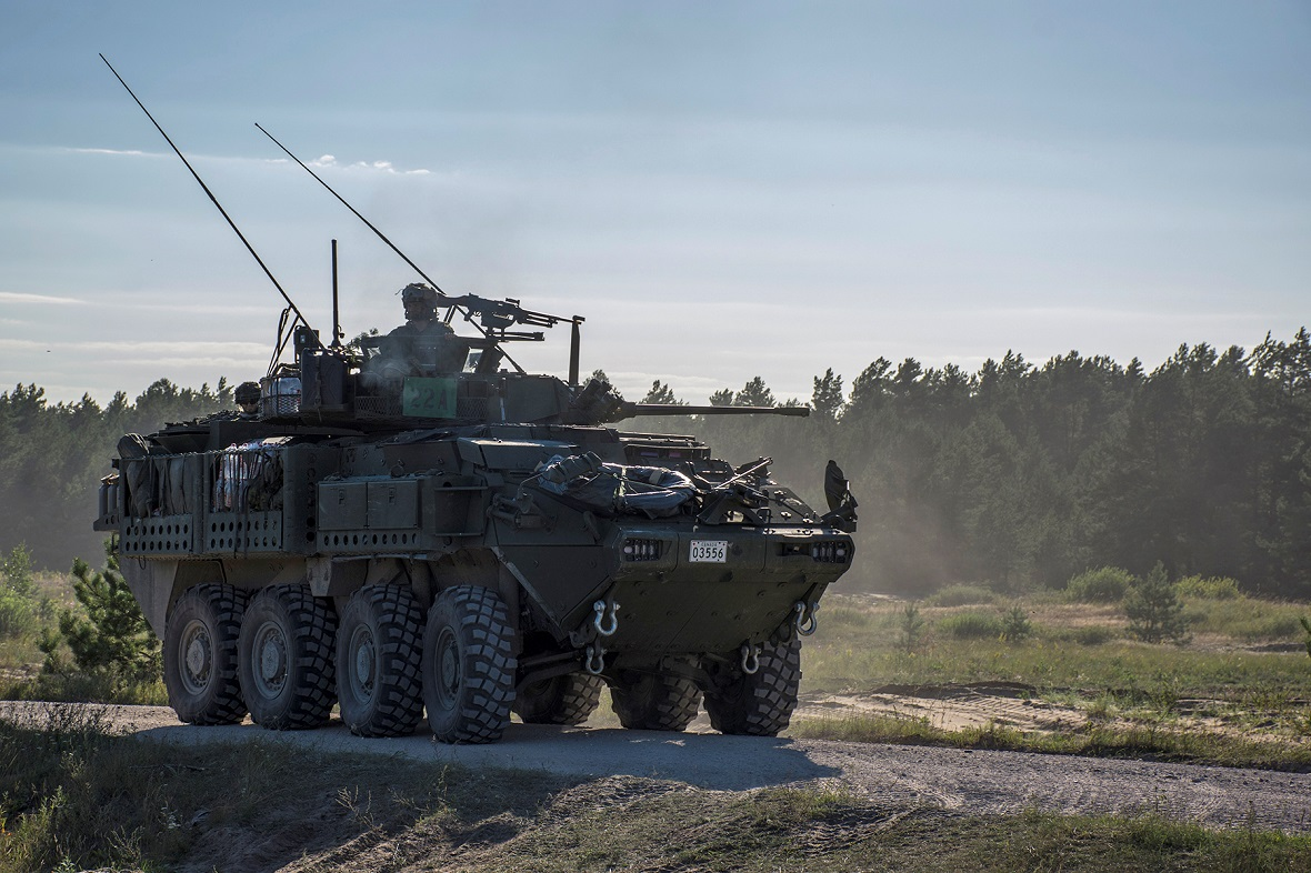A Light Armoured Vehicle 6.0 (LAV 6) occupies a position during an exercise rehearsal during Operation REASSURANCE in Adazi, Latvia on August 9, 2017. Photo: MCpl Gerald Cormier, eFP BG LATVIA PUBLIC AFFAIRS