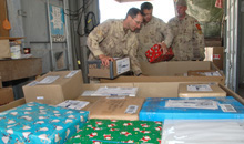 Kandahar, Afghanistan. 11 Dec 2007 - Mail clerks and a traffic technician (right) from the National Support Element sort packages from Canada at Kandahar Airfield, Afghanistan during the holiday season. (Photo by Cpl Simon Duchesne, photographer, JTF HQ, Roto 4)