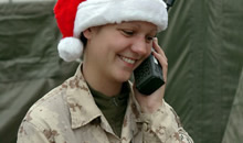 Kandahar, Afghanistan. 25 December 2006 - Private Melissa Wiseman, a medic with 2 Field Ambulance stationed at Forward Operating Base Ma'sum Ghar gets into the spirit on Christmas morning and manages to get a call through to home on a satellite phone. (Photo: Sergeant Dennis Power, Canadian Armed Forces)