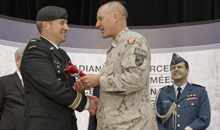 Ottawa, Ontario. 18 March 2014 - Major-General Dean Milner, Commander of the Canadian Contribution Training Mission in Afghanistan, presents the last Canadian Flag that was flown in Kabul and lowered on 12 March 2014 to Major Jay Feyko of Soldier On. The flag will be carried by Canadians injured in Afghanistan from Trenton to Ottawa during the Soldier On Afghanistan Relay from 4 to 9 May 2014. The flag will then be presented to the Prime Minister of Canada on the National Day of Honour, 9 May 2014. (Photo CC2014-0010-13 by Cpl Shilo Adamson)