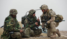 Pol-e-Charkhi, Afghanistan. 17 December 2012 - Captain André Parent (right) from 34 Combat Engineer Regiment in Westmount, Quebec, verifies the radio communications with an Afghan National Army soldier, Infantry 2/4/215, during a training scenario at the Consolidated Fielding Centre training area. (Photo by: MCpl Marc-Andre Gaudreault, Canadian Forces Combat Camera)