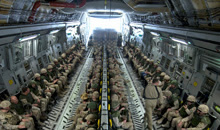 Kandahar, Afghanistan. 19 February 2009- Canadian Forces personnel, completing their tour of duty, sit and await their departure aboard the CC-177 Globemaster III strategic transport aircraft at Kandahar Airfield, Afghanistan in February 2009. (Photo by: MCpl Robert Bottrill, CF Combat Camera)