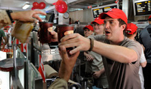 Kandahar, Afghanistan. 01 July, 2011- Canadian comedian and television personality, Rick Mercer serves Tim Hortons coffee to Canadian Forces troops at Kandahar Airfield on Canada Day. (Photo by: Sergeant Matthew McGregor, Canadian Forces Combat Camera)