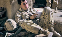 Kandahar, Afghanistan. 26 November 2009- Sapper Mathew Blancowe, a Combat Engineer attached to Delta Company, takes a moment during some down time to write a letter home. (Photo by Master Corporal Angela Abbey, Canadian Forces Combat Camera)