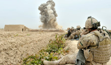 Panjwa'i District, Afghanistan. 28 October 2010- Patrol personnel watch from a safe distance as a cratering charge detonates. (Photo by Sgt Daren Kraus, Task Force Kandahar, Afghanistan, Image Tech, Roto 9)