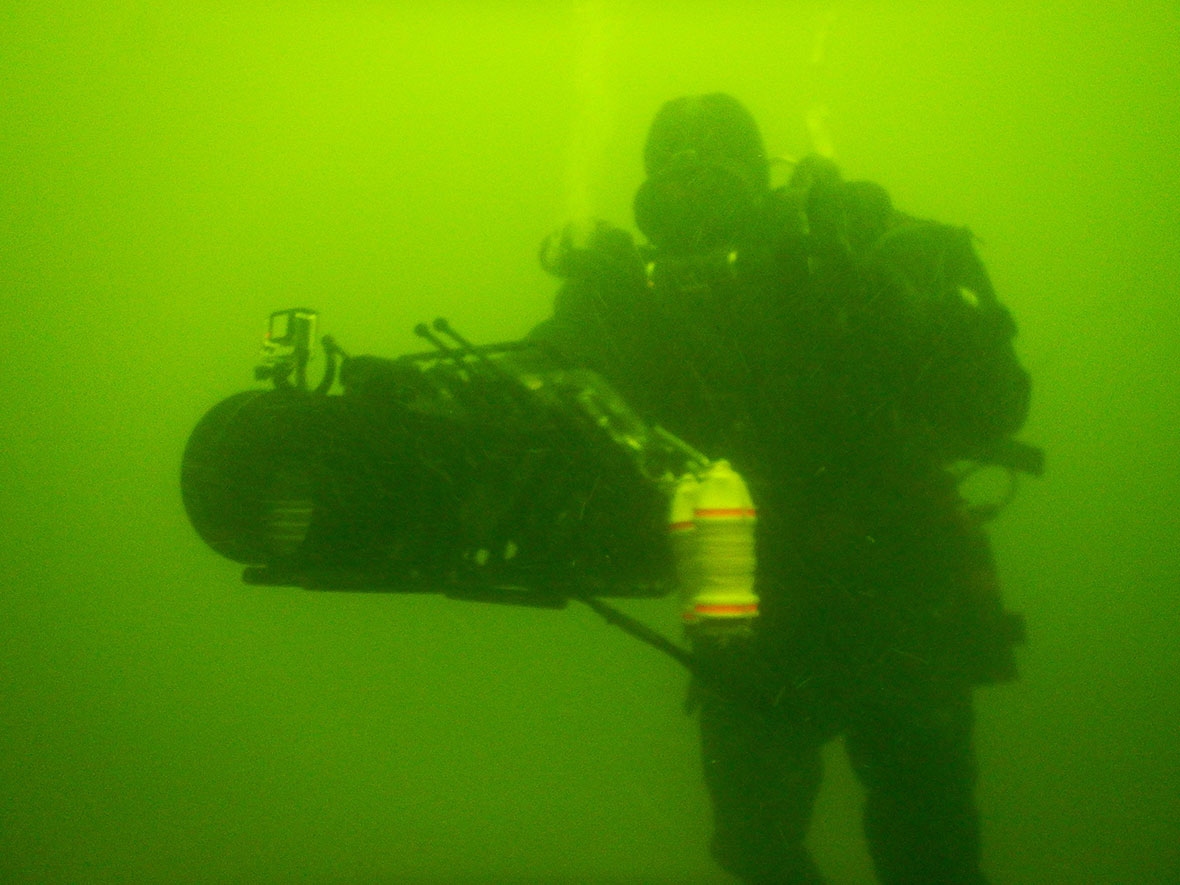 A clearance diver searches for mine-like contacts underwater in the Baltic Sea during Operation OPENSPIRIT. Photo: DND