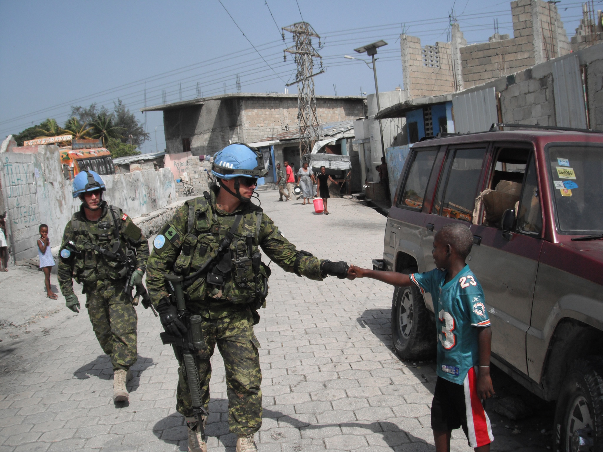 Haitian child thanks a Canadian soldier.