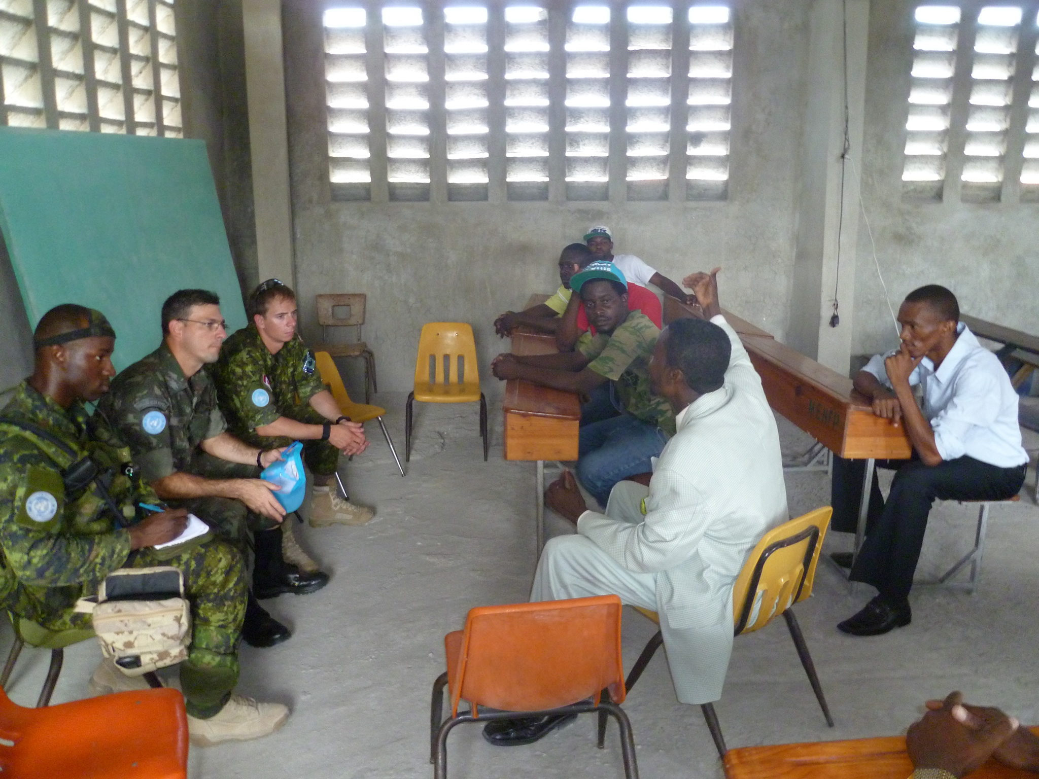 Port-au-Prince, Haiti, 22 June 2013: Soldiers participate in a neighbourhood meeting in their area of operation. Canadian Forces members, in collaboration with Brazilian troops, are participating in stability and security efforts in Haiti. (Photo: Canadian Armed Forces)