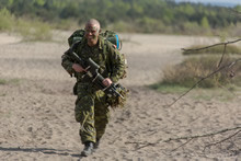 Blendowska, Poland. 5 May 2014 – Private Cole Smith from 3rd Battalion, Princess Patricia's Canadian Light Infantry, walks to his muster point after jumping during Exercise ORZEL ALERT. (Photo Jacek Szymanski DNPA/CF Combat Camera)
