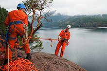 September 16, 2015. Search and rescue technician, Master Corporal Ashley Barker repels down the side of a steep cliff during a mountain rescue scenario at Comox Lake during the National Search and Rescue Exercise 2015 (SAREX15) held at Comox, British Columbia on September 16, 2015. (Photo:  Sgt Halina Folfas, 19 Wing Imaging)
