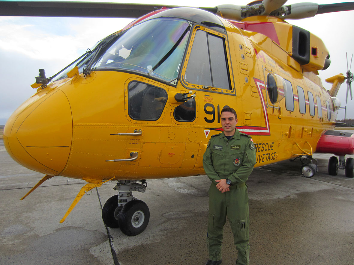 Captain Luc Coates, the aircraft captain from the crew of the November 5 medical evacuation, stands in front of a Cormorant helicopter in Gander, Newfoundland. (Photo: Capt Paul Hamlyn, 9 Wing Public Affairs Officer)