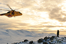 February 12, 2016. Members from 103 Squadron Gander, NL prepare to perform a hoisting sequence from inside the CH-149 Cormorant helicopter during a joint search and rescue exercise held in Iceland on February 12, 2016. (Photo: Master Corporal Johanie Maheu, 14 Wing Imaging Greenwood)