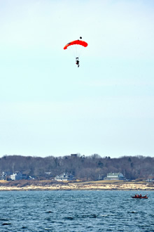 Cape Cod, Massachusetts. 2 April 2015 - A Search and Rescue technician from 413 Squadron, 14 Wing Greenwood NS, Canada parachutes into the ocean during Operation Orange Flag in Cape Cod (Photo: LS Eduardo Jorge, 14 Wing Imaging)