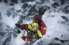 St.John's, Newfoundland and Labrador. 21 March 2011 – Sergeant Dan Leger, Search and Rescue Technician, is hoisted out of the CH-149 Cormorant Helicopter during a 103 Squadron Search and Rescue Exercise. (photo by Corporal Jax Kennedy, Canadian Forces Combat Camera)